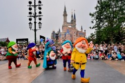 Where's Snow White? Some of the seven dwarves greet visitors during a trial run of Shanghai Disney Resort on June 11 in Shanghai, China.