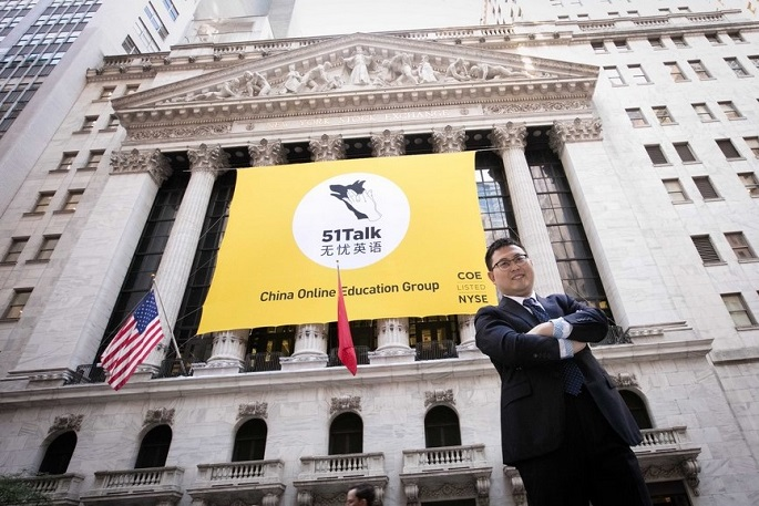 51 Talk founder and CEO Huang Jiajia stands outside the New York Stock Exchange in Lower Manhattan, New York City, on June 10. His language training company went public on June this year.