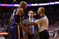 Power forward David West (L) and head coach Frank Vogel talking to a referee during their time together with the Indiana Pacers.