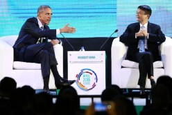 U.S. President Barack Obama gestures as he talks to Alibaba CEO Jack Ma during the Asia-Pacific Economic Cooperation (APEC) CEO Summit in Manila, Philippines, on Nov. 18, 2015.