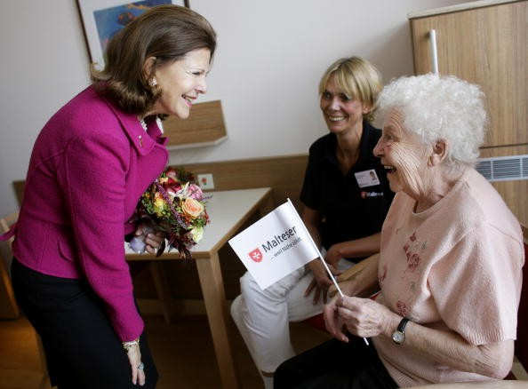 Queen Silvia of Sweden talks to inpatient Margarete Weier, 79, during the opening of the first German section in a hospital for dementia patients  on October 17, 2009 in Cologne, Germany.