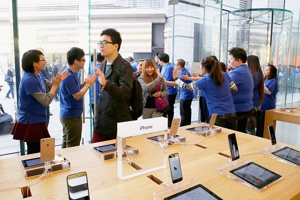 Apple store employees welcome the customers to buy iPhone 6 and iPhone 6 Plus at an Apple store on Oct. 17, 2014 in Beijing, China.