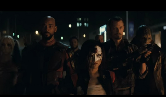"In the scene of ""Suicide Squad,"" the villains are gathered and set to fight."