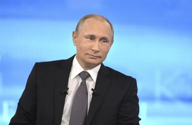 Russian President Vladimir Putin appears on Russian television during a live broadcast in Moscow.