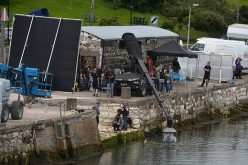 "Maisie Williams, who plays Ayra Stark on ""Game of Thrones,"" is filmed during a water scene for the new series on Aug. 17, 2015 in Carnlough, Northern Ireland."