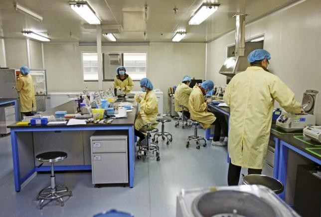 Researchers work at a genomics laboratory in Tianjin.