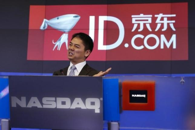 JD.com CEO and founder Richard Liu speaks at the NASDAQ Market site at Times Square in New York.