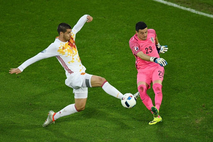 Spain striker Alvaro Morata shoots the ball against Croatia goalkeeper Danijel Subasic.