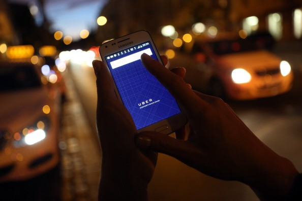 A woman uses the Uber app on a Samsung smartphone on Sept. 2, 2014, in Berlin, Germany.