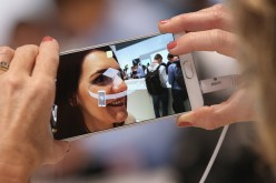 A visitor tries out the camera on a Galaxy Note 5 smartphone at the Samsung stand during a press day at the 2015 IFA consumer electronics and appliances trade fair on Sept. 3, 2015 in Berlin, Germany.