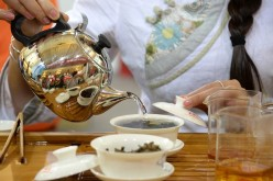 A tea art specialist makes tea during the Beijing International Tea Expo 2016, June 24, 2016.
