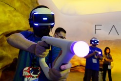 Gamers try out the new Sony VR headset in Sony Playstation booth during the annual E3 2016 gaming conference at the Los Angeles Convention Center on June 14, 2016 in Los Angeles, California.