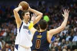 Dirk Nowitzki #41 of the Dallas Mavericks looks to pass against Kevin Love #0 of the Cleveland Cavaliers at American Airlines Center on March 10, 2015 in Dallas, Texas