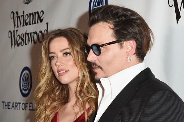 Actors Amber Heard (L) and Johnny Depp attend The Art of Elysium 2016 HEAVEN Gala presented by Vivienne Westwood & Andreas Kronthaler at 3LABS on January 9, 2016 in Culver City, California.