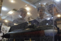 Sailors look at a model of a submarine to be delivered to Vietnam.