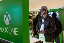A man plays an Xbox One while waiting in line to buy an Xbox One from a Microsoft 'pop-up shop' at the Time Warner Center at Columbus Circle on Nov. 22, 2013 in New York City.