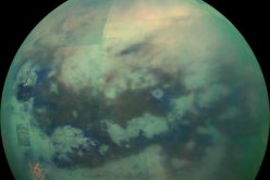 This composite image shows an infrared view of Saturn's moon Titan from NASA's Cassini spacecraft, acquired during the mission's