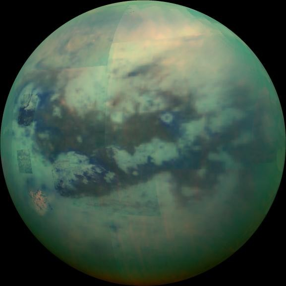"""This composite image shows an infrared view of Saturn's moon Titan from NASA's Cassini spacecraft, acquired during the mission's """"T-114"""" flyby on Nov. 13, 2015."""