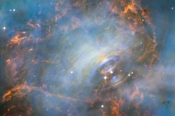 The violent heart of the Crab Nebula located 6,500 light years away.