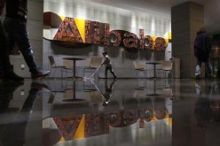 Employees walk past the lobby of Alibaba headquarters in Hangzhou, Zhejiang Province.