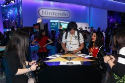 Game enthusiasts test new game titles at the Nintendo exhibit during the Annual Gaming Industry Conference E3 at the Los Angeles Convention Center on June 16, 2015 in Los Angeles, California.