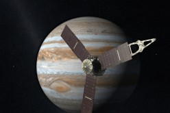 The Juno space probe is seen approaching Jupiter.