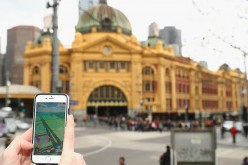 Tristan plays the Pokemon Go game on his phone in front of Flinders Street Station on July 13, 2016 in Melbourne, Australia.