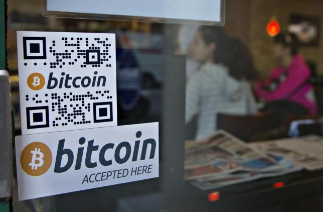 An establishment displays a sign showing that Bitcoin is accepted as payment.
