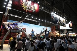 Attendees visit the Capcom Co. booth to play the company's 'Monster Hunter 4' during the Tokyo Game Show 2012 at Makuhari Messe.