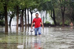 A villager walking in the flood of Niushan Lake on July 14, 2016 in Wuhan, Hubei Province, China.
