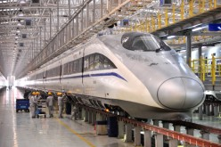 Mechanics check a high-speed train at Xi'an Electric Multiple Unit (EMU) Maintenance Base on January 7, 2014 in Xi An, China.