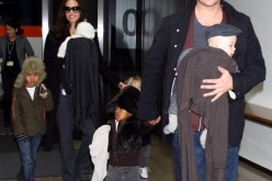 ctor Brad Pitt and Angelina Jolie arrive at Narita International Airport with their children (L to R) Maddox, Vivienne, Zahara and Knox on January 27, 2009 in Narita, Chiba, Japan. Brad is visiting Japan to promote his film 'The Curious Case Of Benjamin B