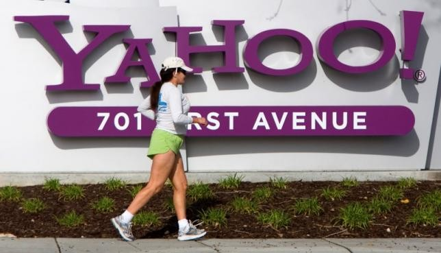 A woman jogs past Yahoo's logo at its headquarters in Sunnyvale, California.