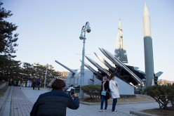 People are taking pictures of a display of model missiles at the War Memorial of Korea on Feb. 7, 2016, in Seoul, South Korea.