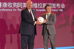 Chinese business tycoon Tony Xia (right) being welcomed by Aston Villa director Keith Wyness as the new owner of the team during a press conference in Beijing.