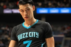 Jeremy Lin looks on as a member of the Hornets during a game last season in Charlotte.