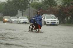 Heavy rains in Beijing have prompted the government to issue orange alert status.