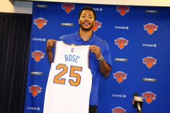 Newly acquired New York Knicks point guard Derrick Rose poses with his new #25 jersey during the Knicks introductory press conference.