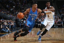 Russell Westbrook drives to the basket against Emmanuel Mudiay at the Pepsi Center last Jan. 19, 2016.