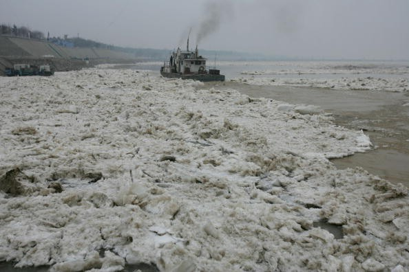 An icebreaker clears ice drift in the Yellow River on Jan. 28, 2008, in Jinan of Shandong Province, China.