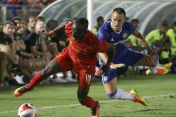 Chelsea captain John Terry (R) competes for the ball against Liverpool's new winger Sadio Mané.