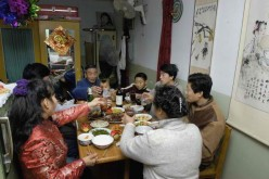 A Chinese family sharing a meal together.