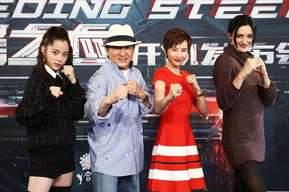 """Nana Ouyang, Jackie Chan, Erica Xia-hou and Tess Haubrich pose during a press conference for """"Bleeding Steel."""""""