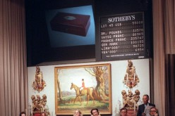 Employees at Sotheby's take calls from bidders during an auction.