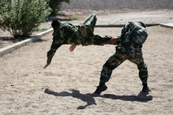 Special Forces soldiers train at their base in Zhangye city, Northwest China's Gansu province, on July 31, 2016, one day before the annual Chinese Army Day on Monday.