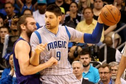 Orlando Magic center Nikola Vucevic posts up against Charlotte Hornets' Spencer Hawes.