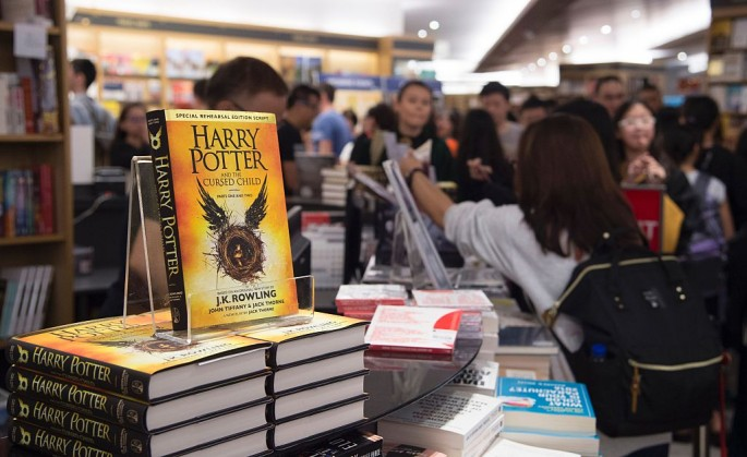 Stacks of new book 'Harry Potter and the Cursed Child' are displayed at a book store during its launch in Singapore on July 31, 2016. Rowling's books have sold more than 450 million copies of harry Potter since 1997 and been adapted into eight films. (Pho