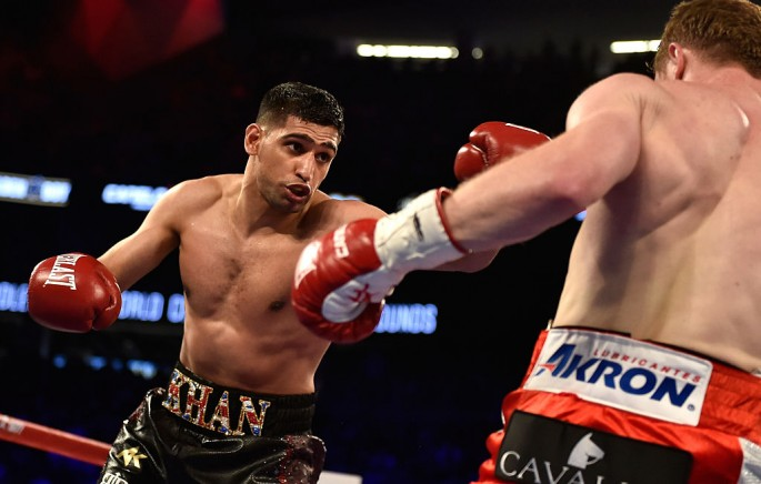 Amir Khan (L) and Canelo Alvarez battle during a WBC middleweight title fight at T-Mobile Arena on May 7, 2016 in Las Vegas, Nevada.