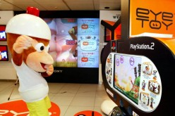 A game character Pipotchi of of the 'Ape Escape 2' demonstrates Sony Computer Entertainment's' motion capture camera 'eyeTOY' for the company's PlayStation 2 video game machine at the Sony's showroom in Tokyo.
