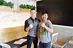 American-Filipino MMA fighter Mark 'Mugen' Striegl poses with Yibada editor Conviron Altatis after an interview in Pasig City, Metro Manila, Philippines.